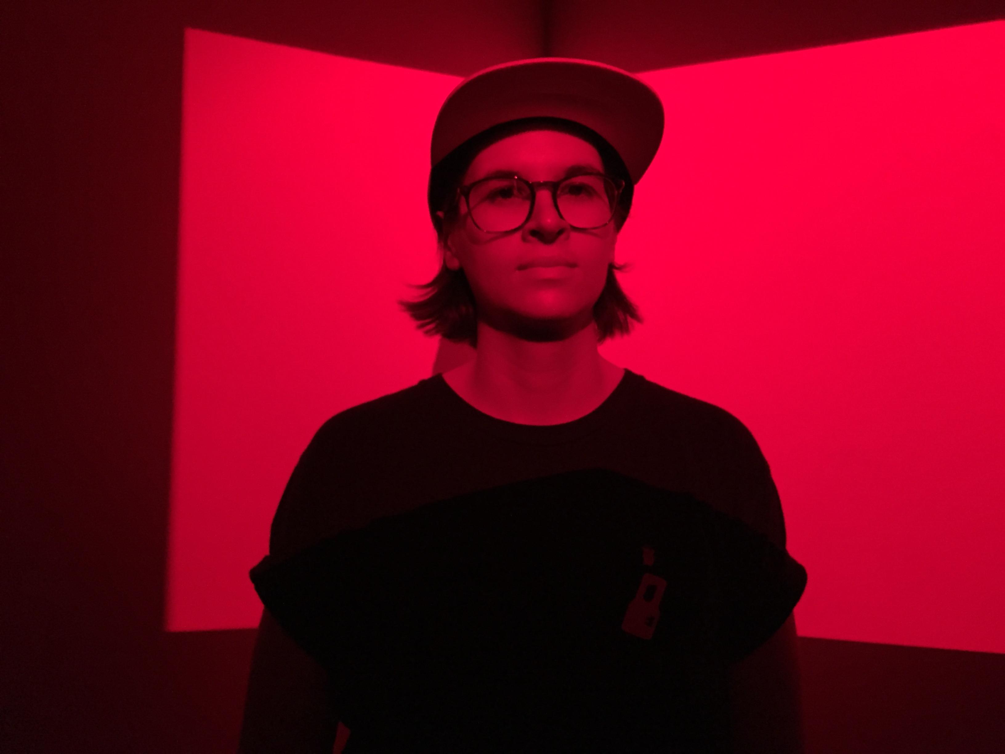 Red screened image of Adrienne Crossman